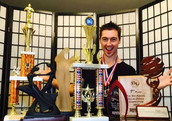 Danny Kalman With Trophies - World Latin Dance Cup